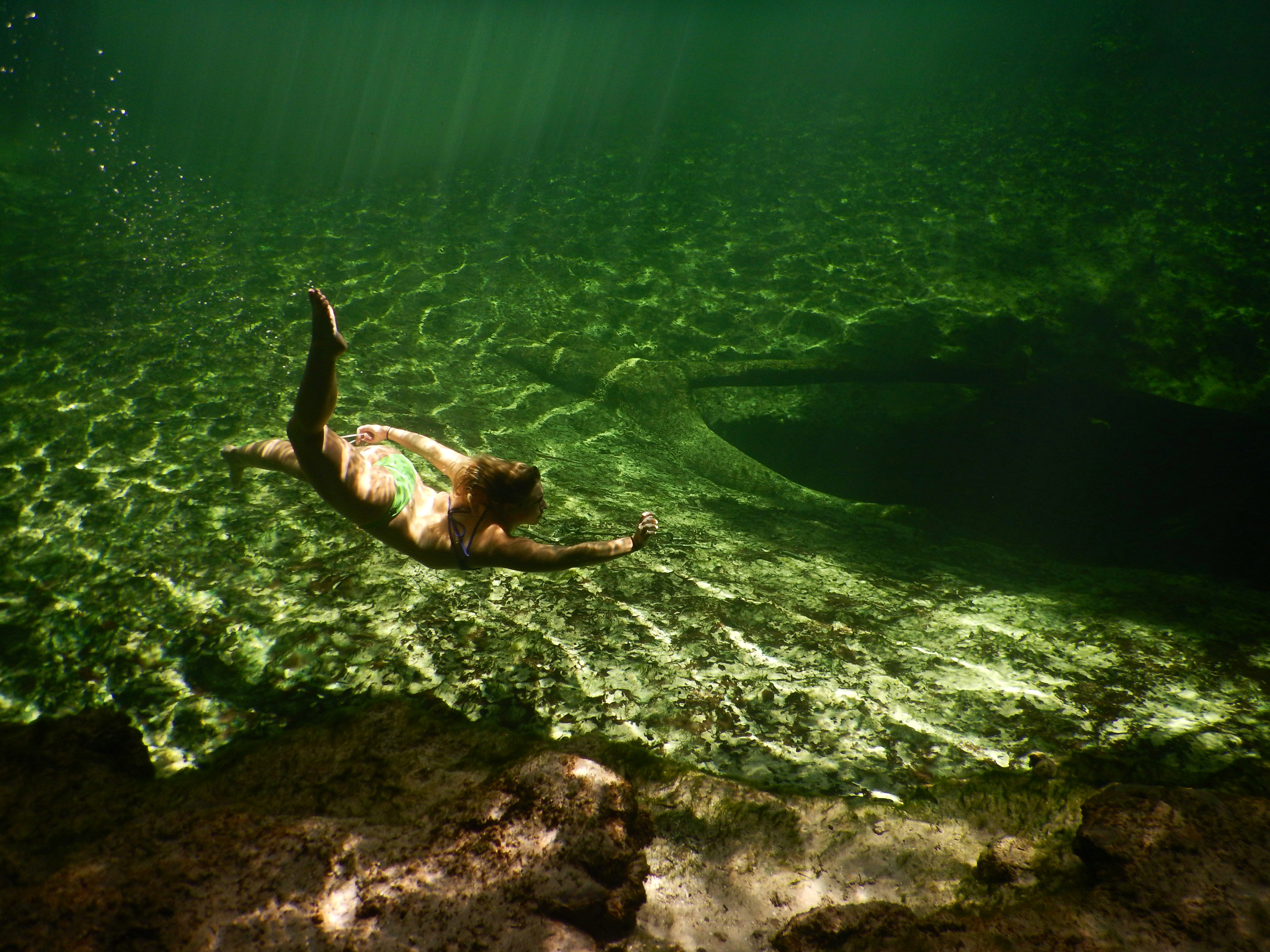 Woman swimming underwater at Blue Spring