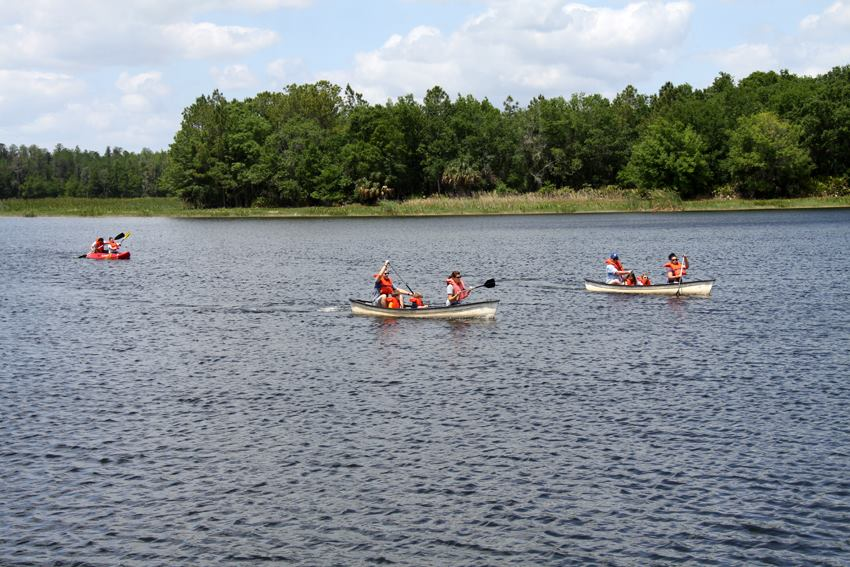3 canoers paddling at Mac Lake