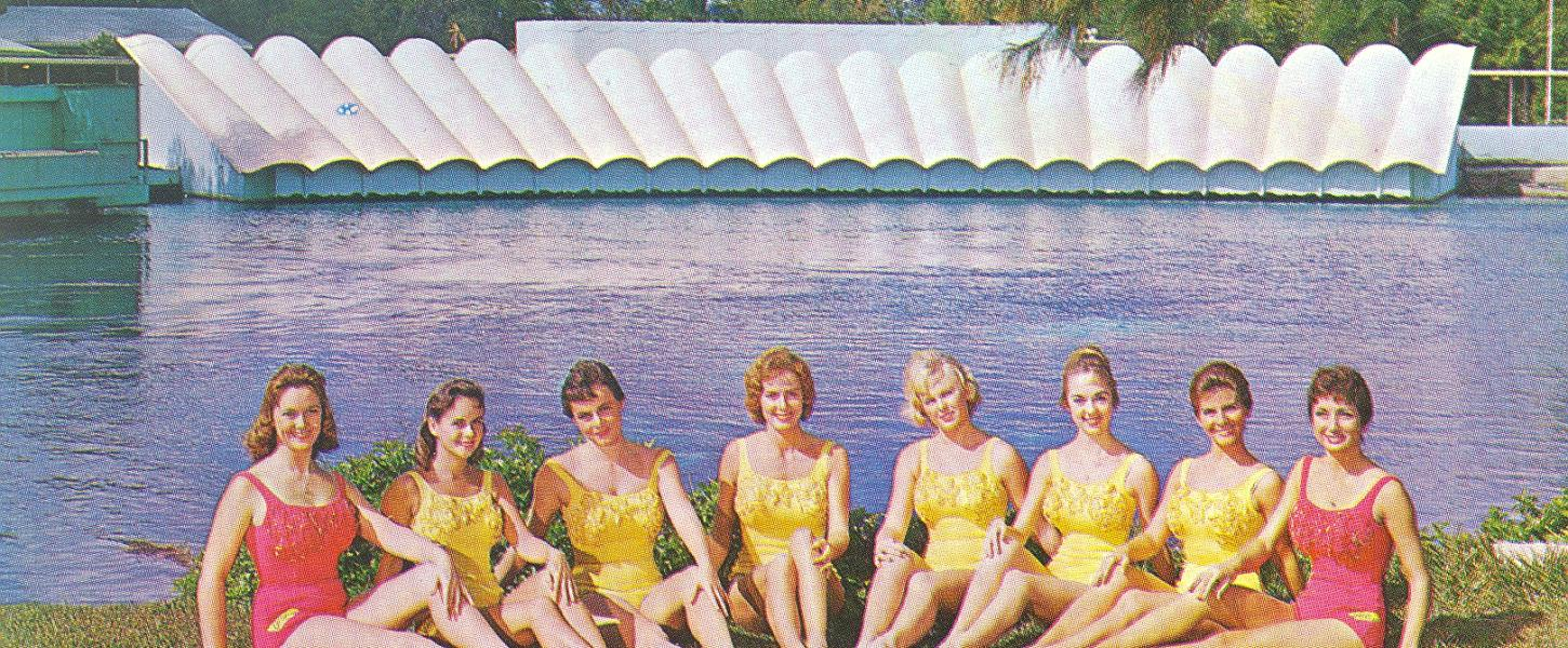 The first group of mermaids lined up in the grass in front of the theater at Weeki Wachee.