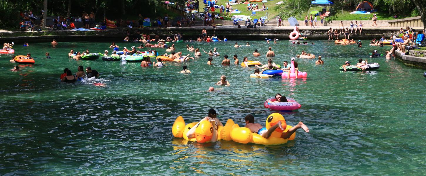 Visitors swimming at Wekiwa Springs with floaties