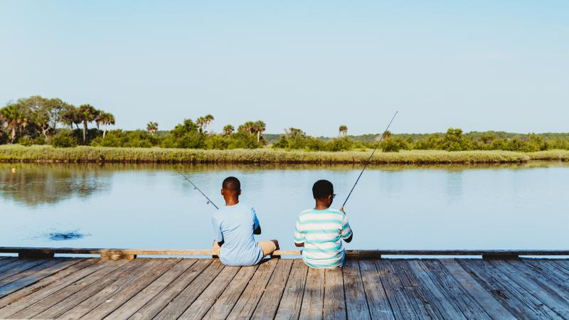 Two boys fishing at Tomoka State Park