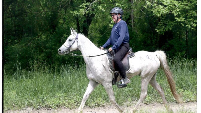 CFG Volunteer Dr. Doug Shearer riding a white horse