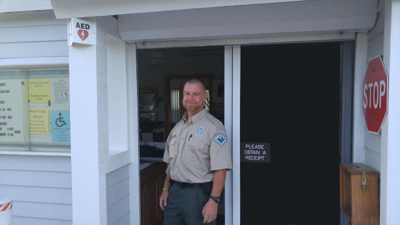 Bryan, standing in the doorway of the ranger station.