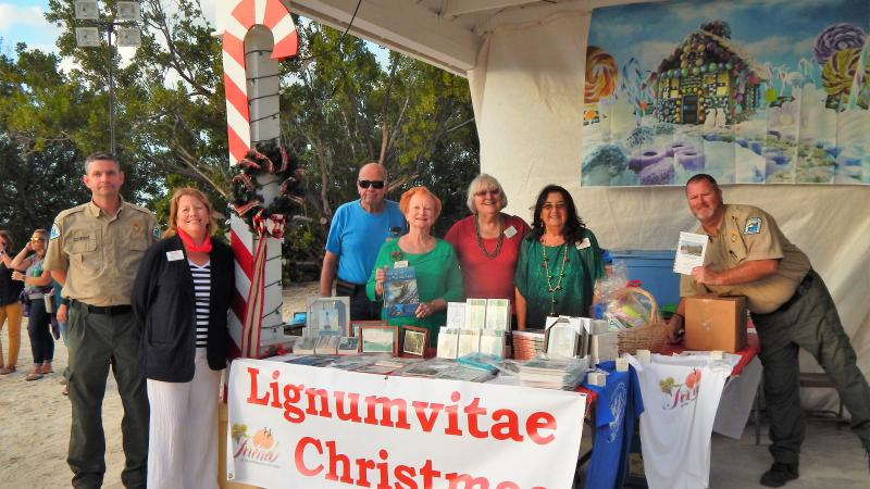 Friends of the Islamorada Area State Parks pose by a booth at the Holiday Festival