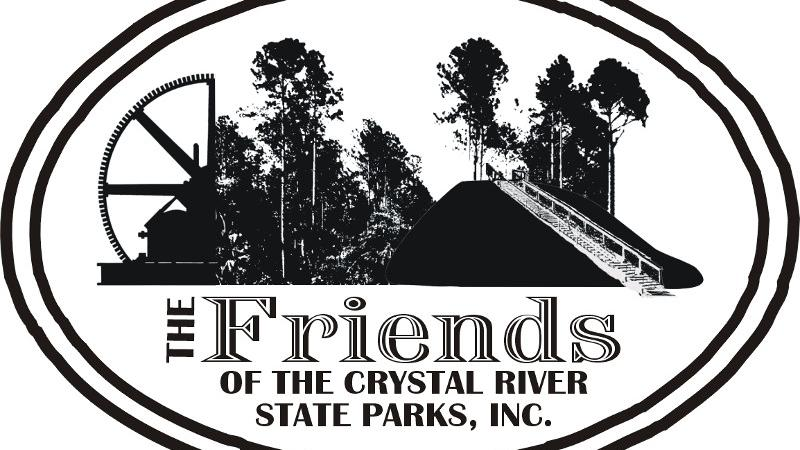 The logo of friends of crystal river state parks in black and white, depicting palm trees and an archaeological mound.