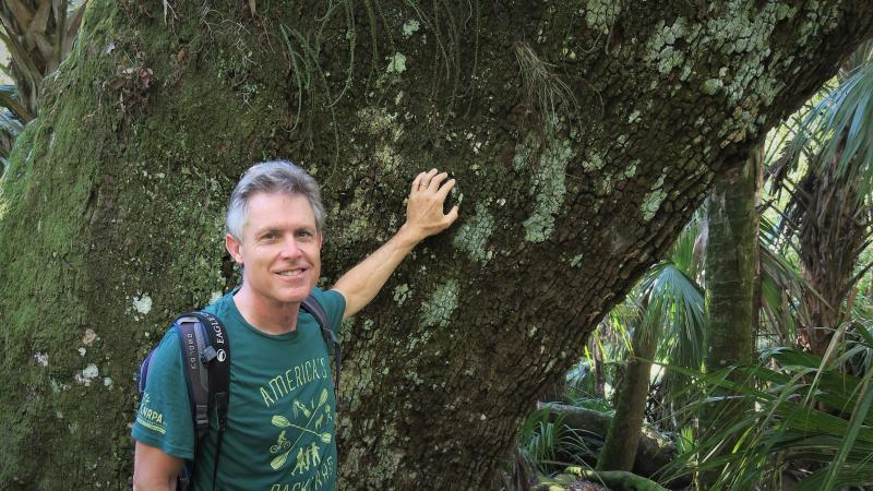 Florida State Parks Director Eric Draper stands in front of a large oak tree at Hontoon Island State Park.