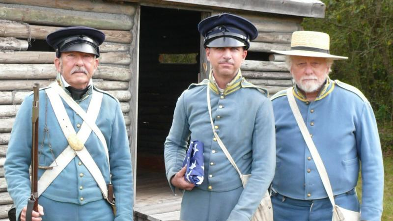 A group of reenactors dressed in uniform.