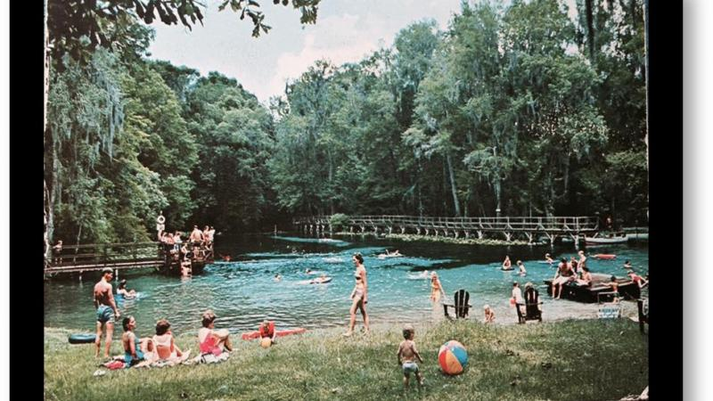 A 1960s image of Gilchrist Blue with people swimming and on shore.