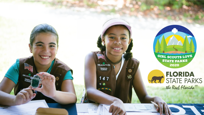 Two Girl Scouts doing Junior Ranger activities.  Includes superimposed Girl Scouts Love State Parks and Florida State Park logos
