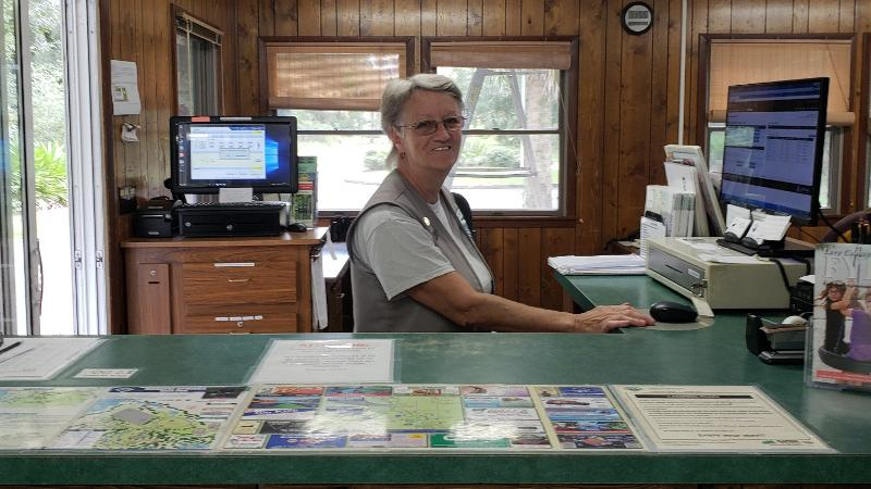 image of linda eldridge, volunteer at manatee springs state park, in the ranger station.
