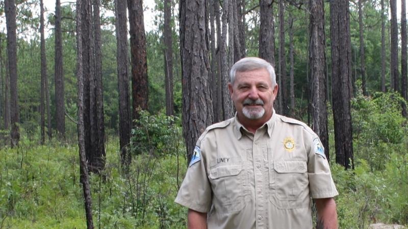 Park Manager Craig LIney in the sandhill with pine trees in background