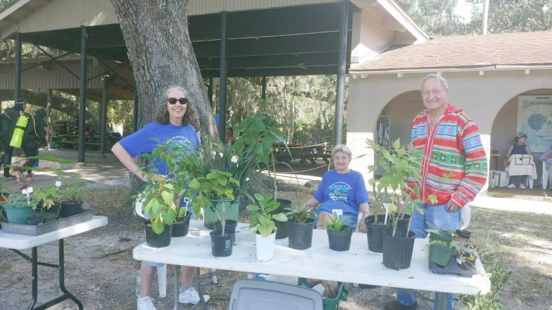 A group of volunteers selling plants from the nursery.