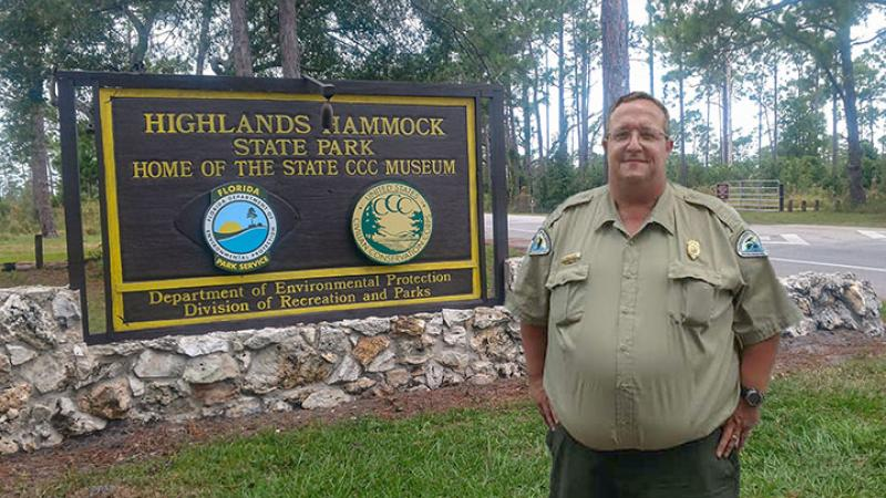 Park Manager Morgan Tyrone at the front entrance of the park