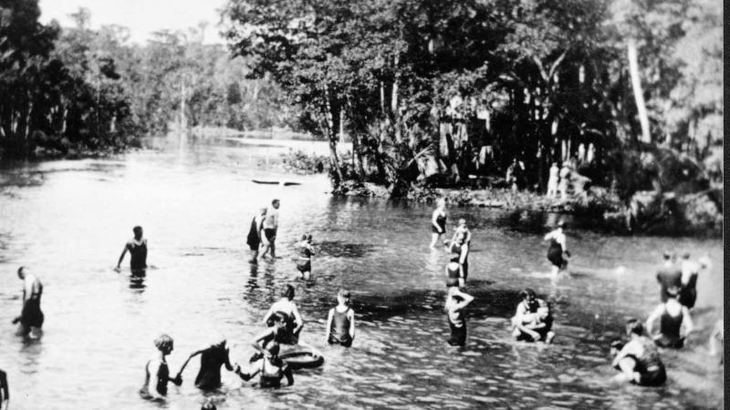 A black and white photo of people enjoying the springs.