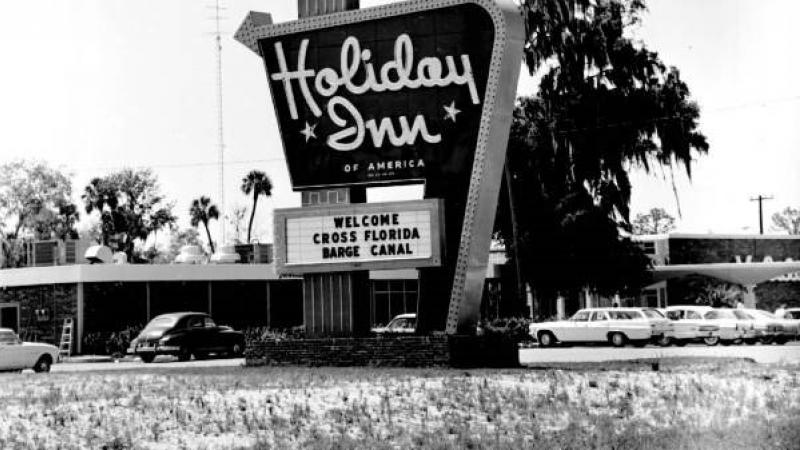 1967 Holiday Inn sign welcoming the Cross-Florida Barge Canal. Black and white image.
