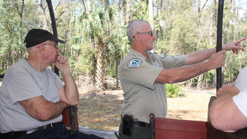 image of a ranger pointing out of a vehicle during a program at manatee springs state park.