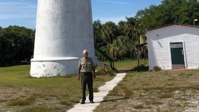 Tom Watson standing in front of the lighthouse at Egmont Key.