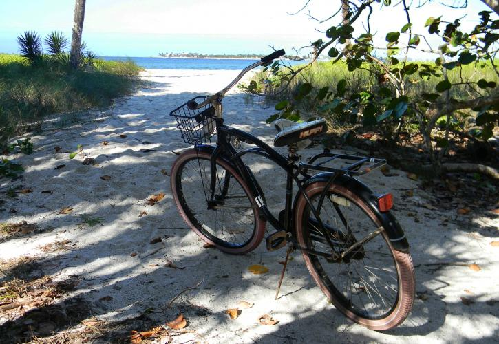 A bike in the middle of a sandy bike trail.
