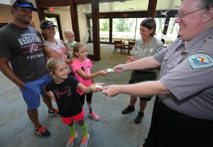Park staff interacting with visitors