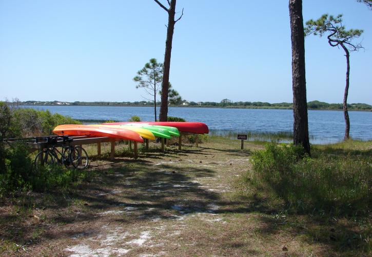 Kayaks waiting by shoreline