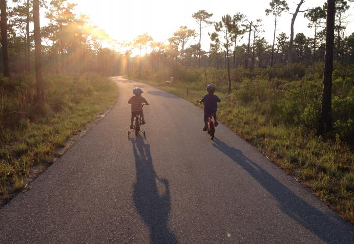Children riding bicycles on paved trail