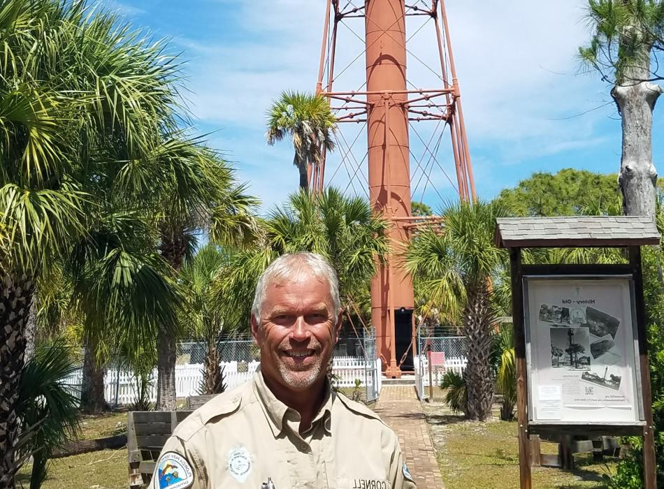 Tod Cornell standing in front of the lighthouse.