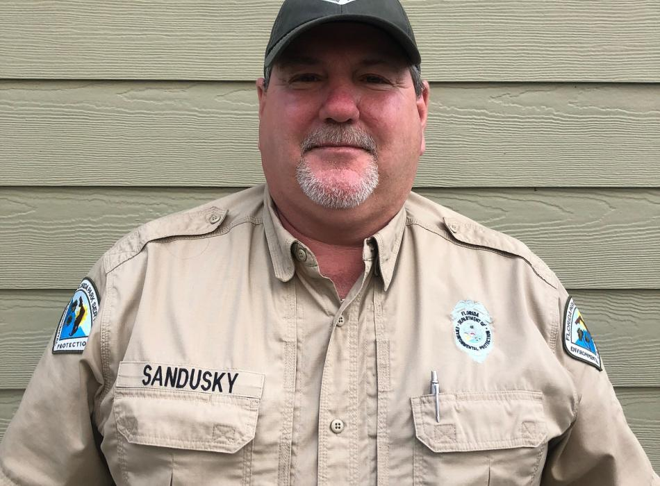 Park Services Specialist Ricky Sandusky smiles ready to greet park visitors.