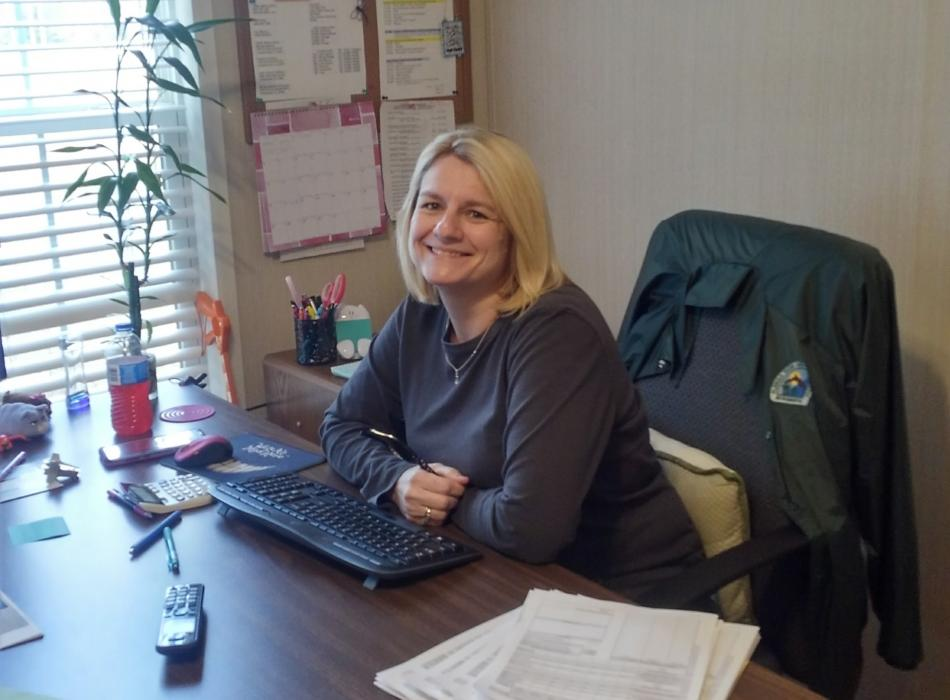 Administrative Assistant Leanne Chandler sits at her desk ready to tackle the days work.
