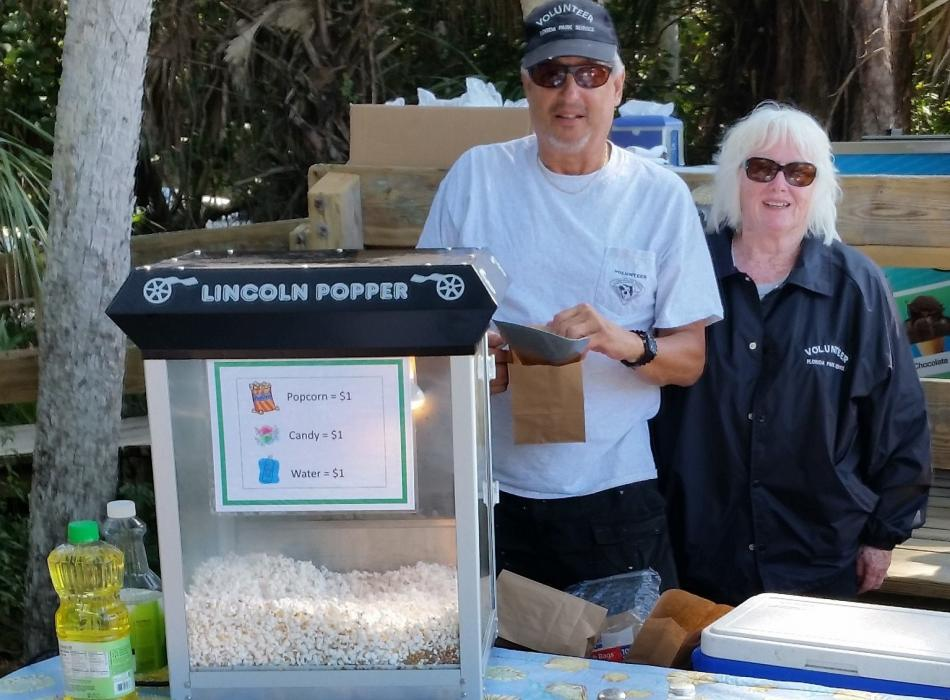 Volunteers Wally and Jacquie with popcorn machine