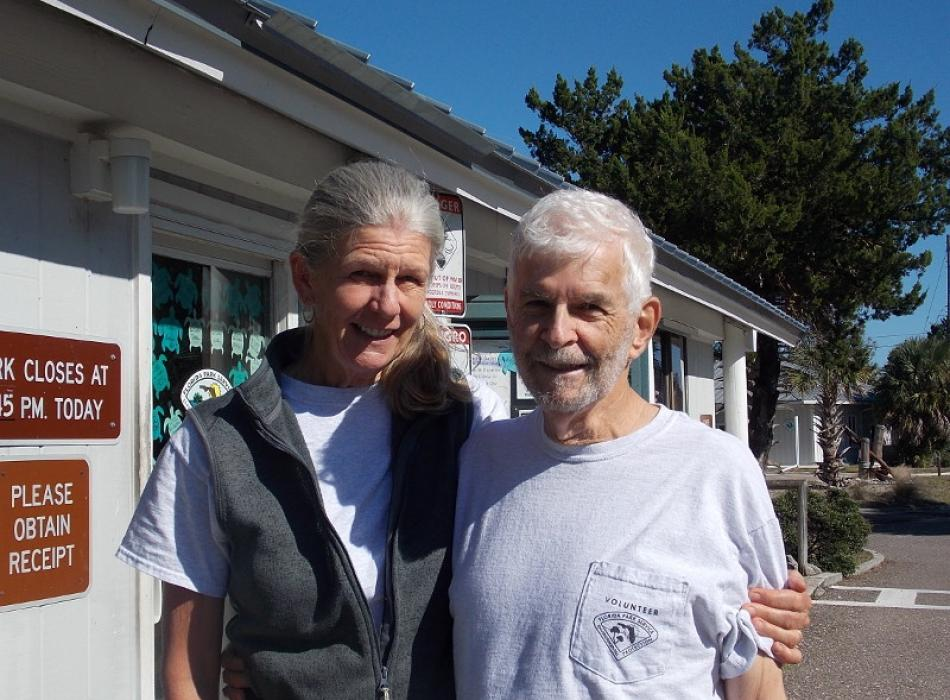 Image of Richard and Joan Becker standing outside a Talbot Island ranger station.